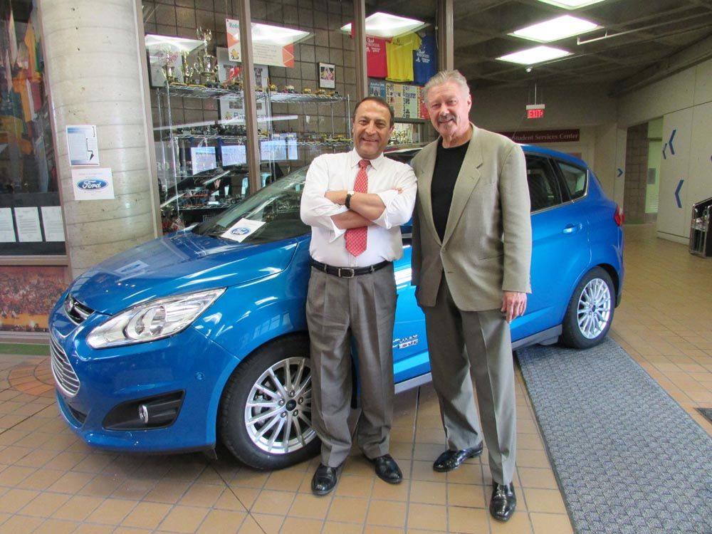 Dr. Mirshab and Gene Gutt in front of the donated car