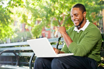 LTU Online - African American Male using Laptop Outdoors