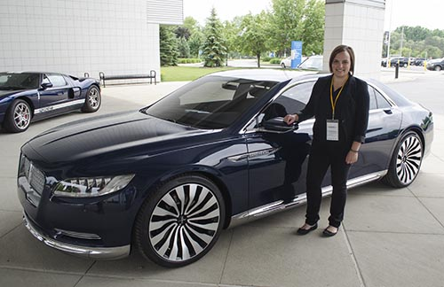 Lindsey Grant poses with the Lincoln Continental concept car
