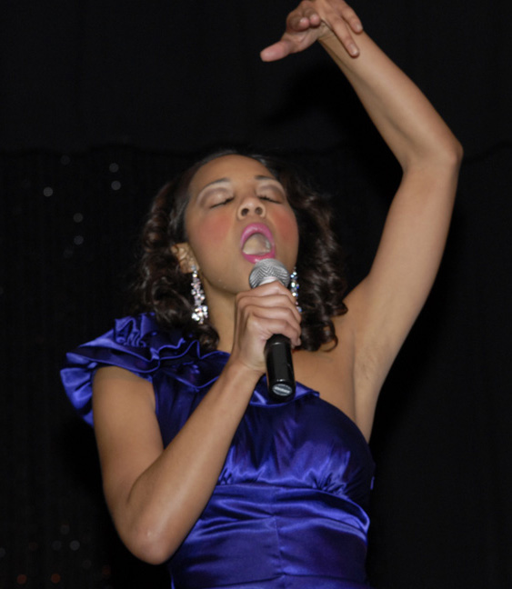 Jasmine Jones singing during talent