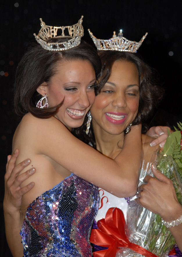 Jenelle Sekol, Miss Lawrence Tech 2010, and Jasmine Jones, Miss Lawrence Tech 2011, celebrate with a hug