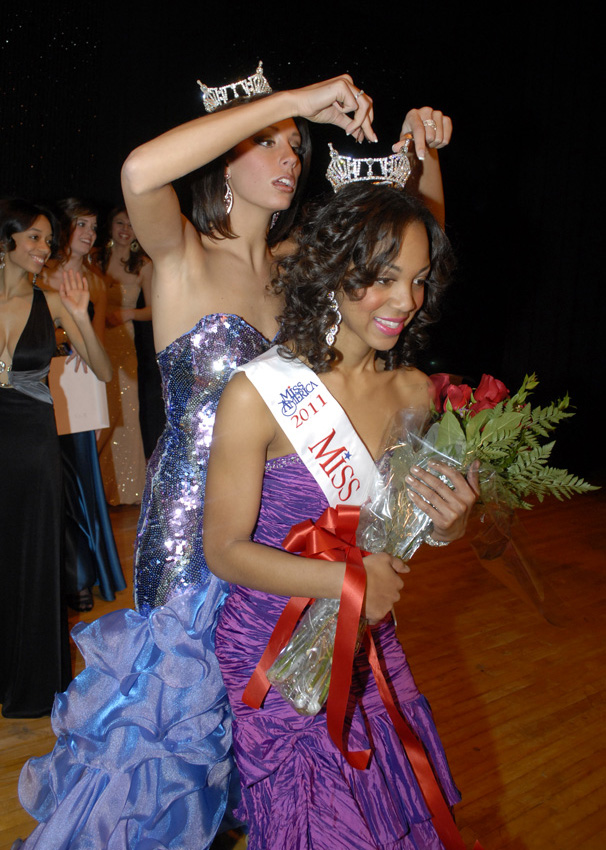 Jasmine Jones, Miss Lawrence Tech 2011, has her crown adjusted by Jenelle Sekol, Miss Lawrence Tech 2010