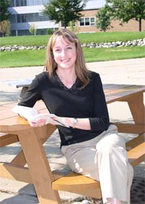 student on picnic bench