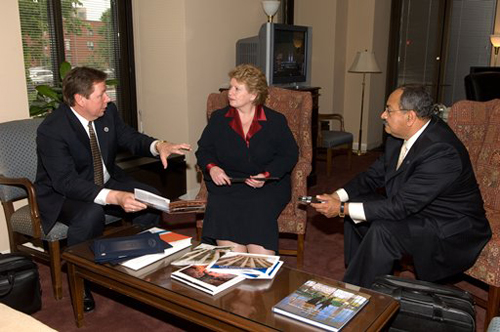 The Honorable Debbie Stabenow, Michigan Senator, talks with Mark Brucki and Dr. Nabil Grace