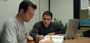 Tutor teaching a student in the AAC