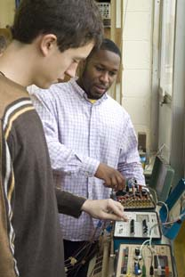 students adjusting circuits