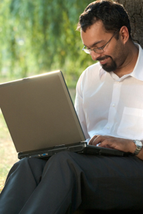 LTU Online - Indian Man using Laptop