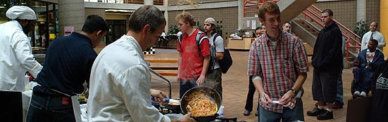 Cafeteria - Dining Services Brent cooking in front of students at the Atrium