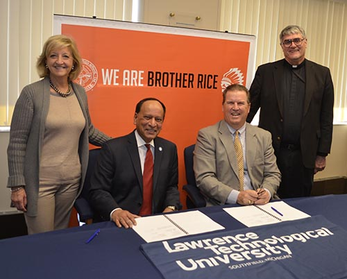 Photo: Provost Maria Vaz, President Virinder Moudgil, Brother Rice President John Birney and Brother Michael Segvich